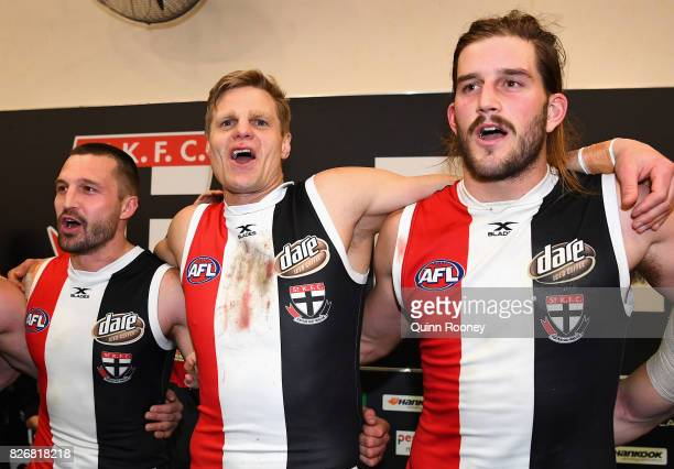 Jarryn Geary Nick Riewoldt and Josh Bruce of the Saints sing the song in the rooms after winning the round 20 AFL match between the St Kilda Saints...