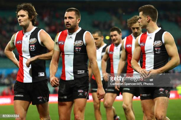 Jarryn Geary of the Saints and team mates look dejected after losing the round 18 AFL match between the Sydney Swans and the St Kilda Saints at...