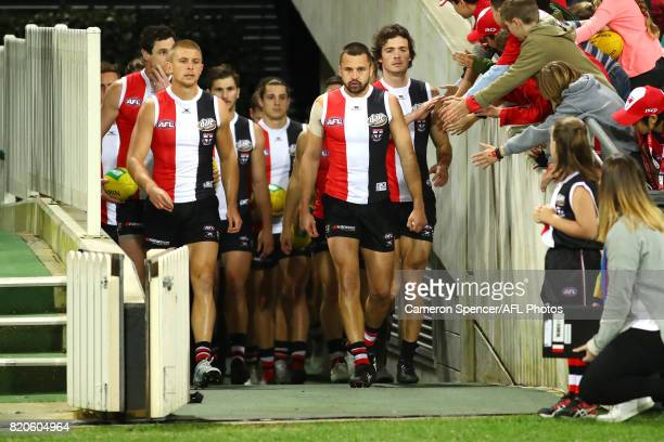 Jarryn Geary of the Saints and team mates walk onto the field during the round 18 AFL match between the Sydney Swans and the St Kilda Saints at...