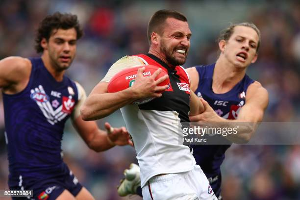 Jarryn Geary of the Saints attampts to break from a atckle by Nathan Fyfe of the Dockers during the round 15 AFL match between the Fremantle Dockers...
