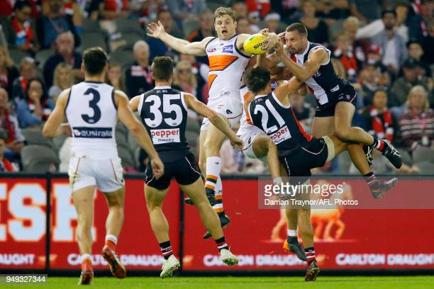 Jarryn Geary of the Saints attempts to mark the ball over Heath Shaw of the Giants during the round five AFL match between the St Kilda Saints and...