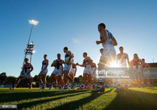 Jarryn Geary of the Saints leads his team onto the field during the AFL 2018 JLT Community Series match between the Melbourne Demons and the St Kilda...