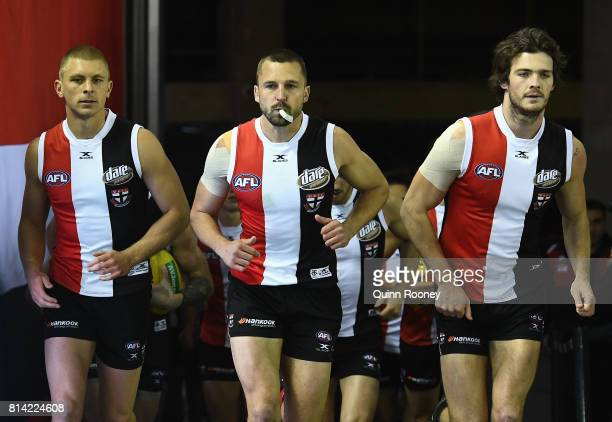 Jarryn Geary of the Saints leads his team out onto the field during the round 17 AFL match between the St Kilda Saints and the Essendon Bombers at...