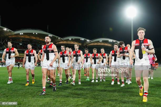 Jarryn Geary of the Saints looks dejected as he leads the team off after defeat during the round 19 AFL match between the Port Adelaide Power and the...