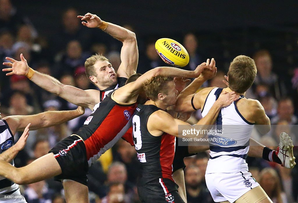 Jarryn Geary of the Saints , Luke Delaney of the Saints and Sam Gilbert of the Saints compete for the ball during the round 14 AFL match between the St Kilda Saints and the Geelong Cats at Etihad Stadium on June 25, 2016 in Melbourne, Australia.