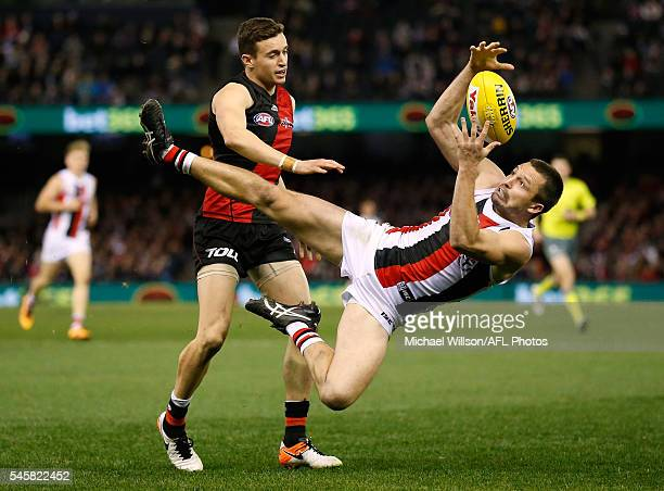 Jarryn Geary of the Saints marks over Orazio Fantasia of the Bombers during the 2016 AFL Round 16 match between the Essendon Bombers and the St Kilda...