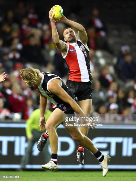 Jarryn Geary of the Saints marks the ball during the round 14 AFL match between the St Kilda Saints and the Gold Coast Suns at Etihad Stadium on June...