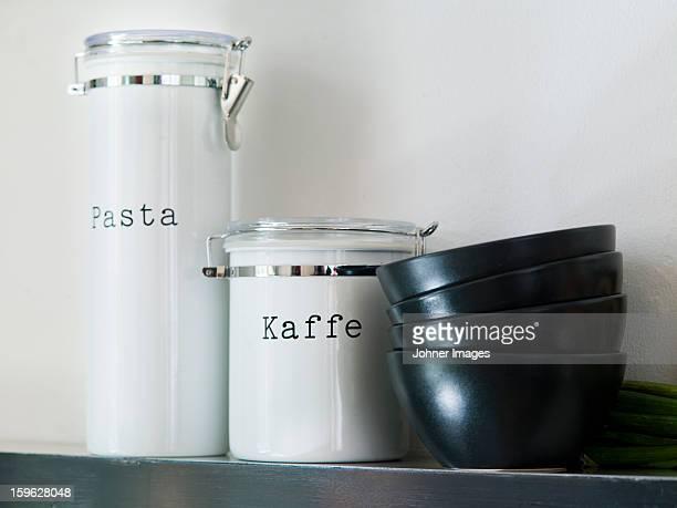 Jars and bowls on shelf