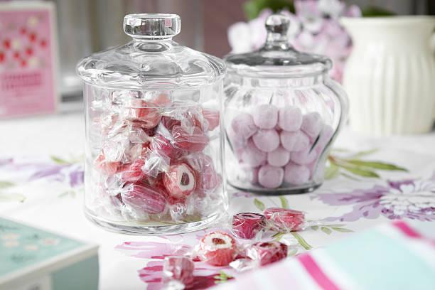 Jars of candies on table