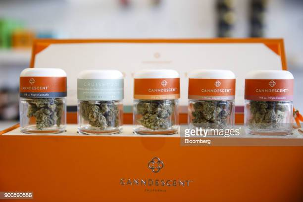 Jars of Canndescent marijuana is displayed for sale at the MedMen dispensary in West Hollywood California US on Tuesday Jan 2 2018 California...