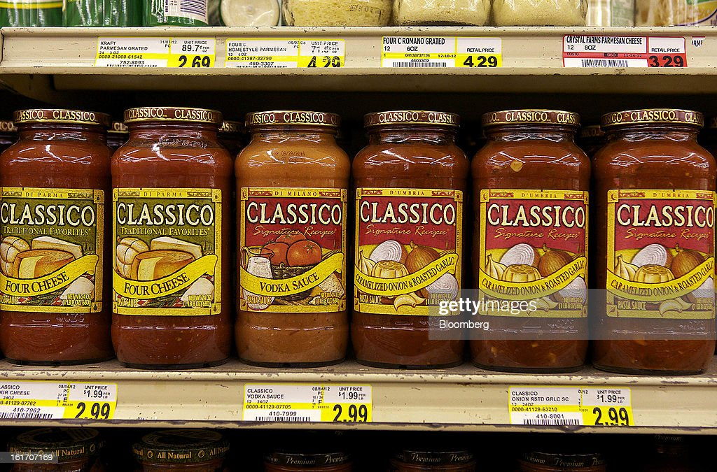 Jars of Classico pasta sauce, made by H.J. Heinz Co., are displayed on a shelf for sale at grocery store in Pittsburgh, Pennsylvania, U.S., on Thursday, Feb. 14, 2013. Warren Buffett's Berkshire Hathaway Inc. and Jorge Paulo Lemann's 3G Capital agreed to buy HJ Heinz Co. for about $23 billion, ending the independence of an iconic ketchup maker that traces its roots to the 1860s. Photographer: Kevin Lorenzi/Bloomberg via Getty Images