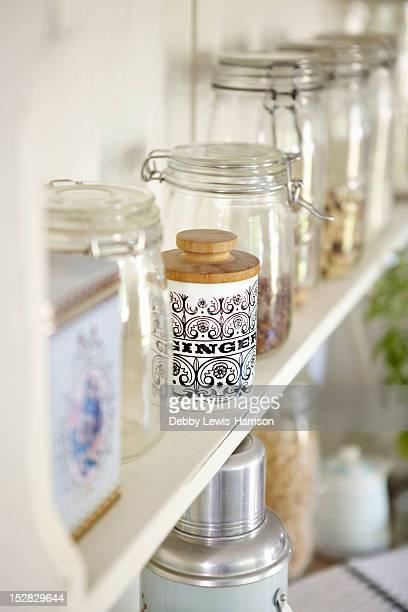 Jars of dried foods on shelf