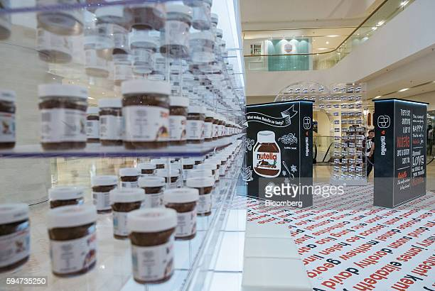 Jars of Ferrero SpA's Nutella hazelnut chocolate spread sit on display at a Nutella pop up store inside Pacific Place shopping mall in the Admiralty...