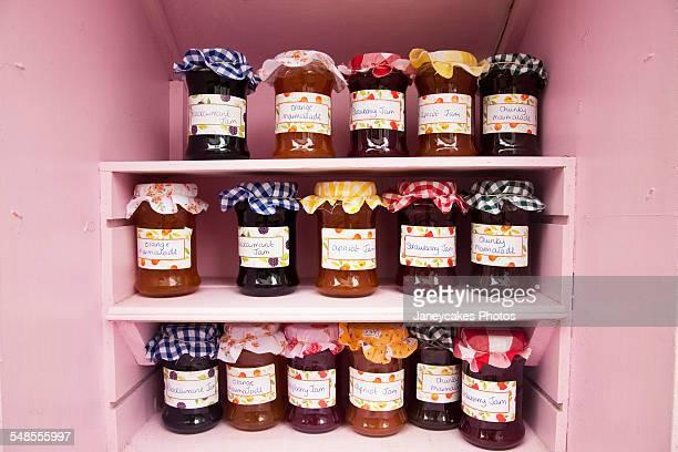 Jars of homemade jam and marmalade on shop shelf