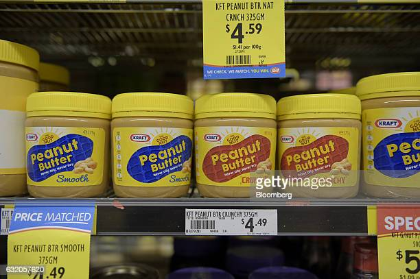 Jars of Kraft Foods Group Inc peanut butter spread sit on a shelf at a grocery store in Melbourne Australia on Thursday Jan 19 2017 Bega Cheese Ltd...