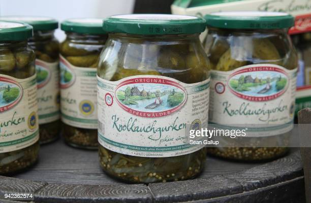 Jars of locallyproduced Spreewalder pickles stand on display for sale at a stand in the Spreewald region on April 5 2018 in Luebbenau Germany The...