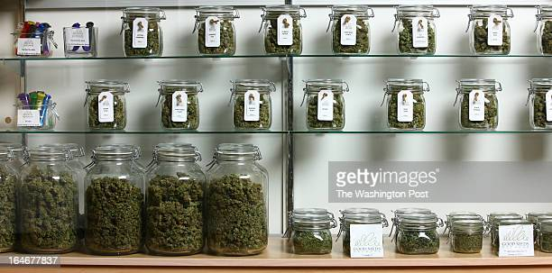 Jars of medical cannabis line the shelves inside a Good Meds medical cannabis center in Lakewood Colorado US on Monday March 4 2013 This is at a Good...