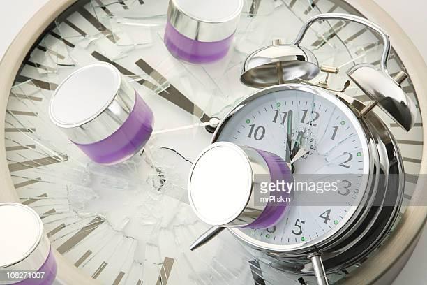 Jars of moisturisers fall and break clock faces (XXL)