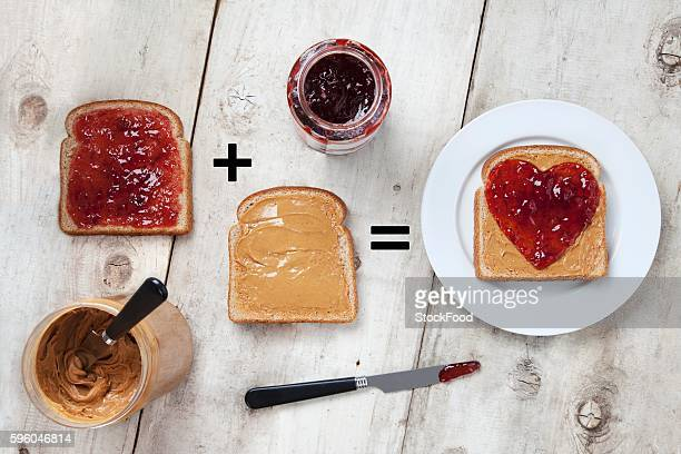 Jars of Peanut Butter and Jelly with Peanut Butter and Jelly on Slices of Bread; Heart Jelly on Peanut Butter Bread