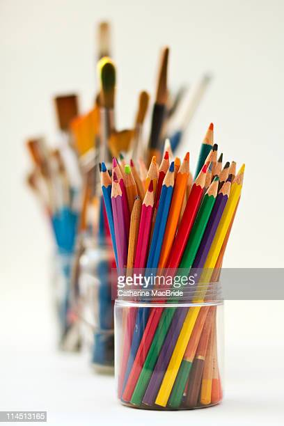 jars of pencils and paintbrushes - catherine macbride stock pictures, royalty-free photos & images