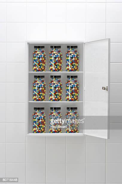 Jars of pills in bathroom cabinet