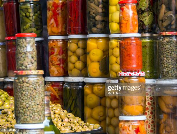 jars of preserved food on the arab street market stall, marrakesh, morocco - luques olive stock pictures, royalty-free photos & images