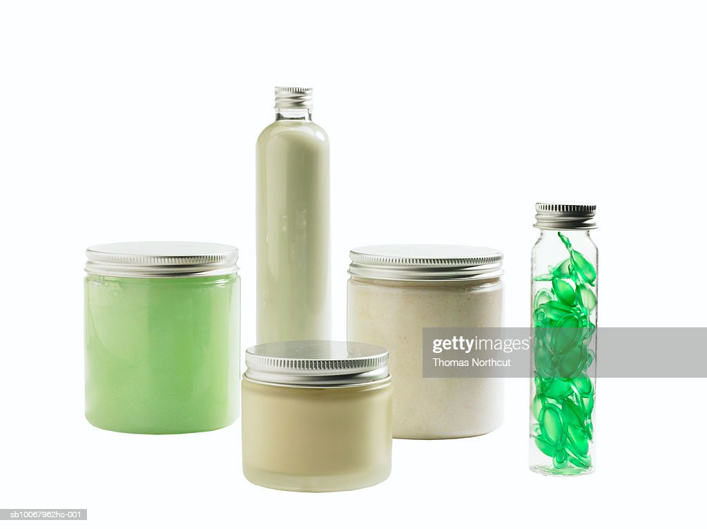 Jars of skin care products on white background : Stock Photo