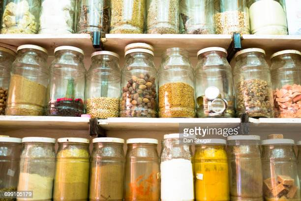 Jars Of Spices And Dried Goods For Sale In A Market Stall