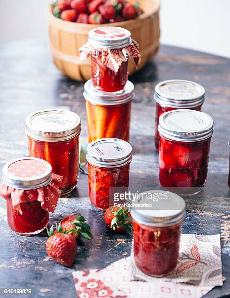jars of strawberry jam - artisan stock photos and pictures