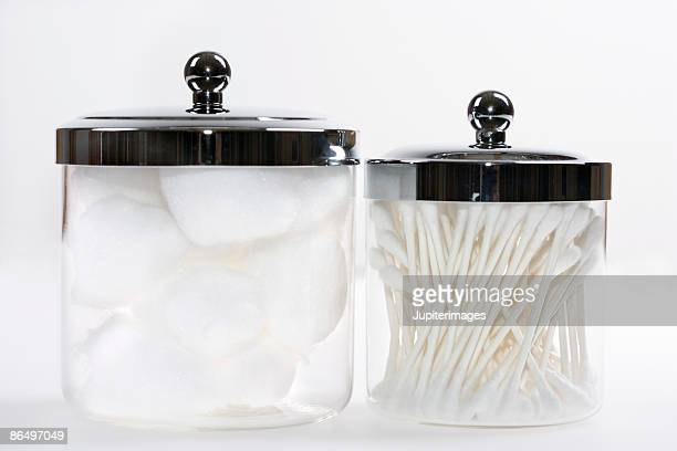 Jars with cotton balls and swabs