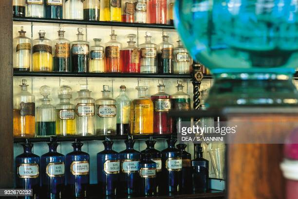 Jars with spices and medicines in a pharmacy, Blist Hill Museum, Ironbridge, Shropshire, England, United Kingdom.