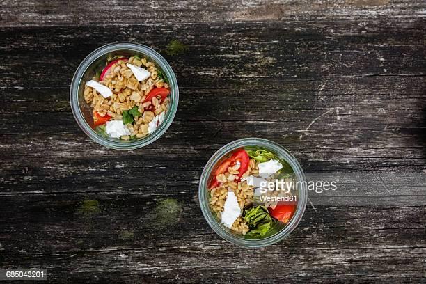 Jars with vegetarian oat salad