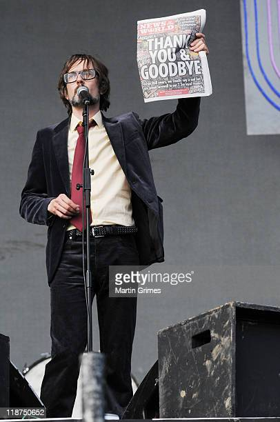Jarvis Cocker of Pulp pretends to use the last edition of The News of The World as toilet paper on the main stage of T In The Park on July 10 2011 in...