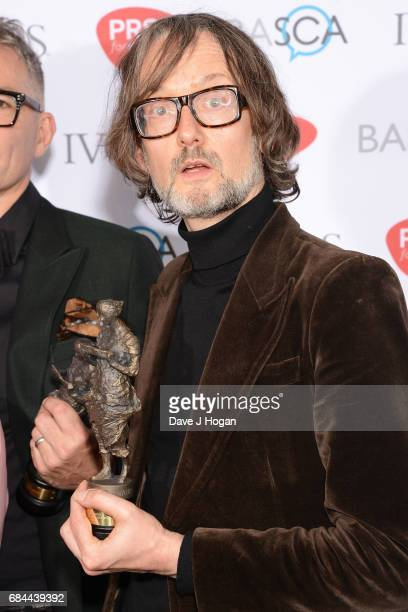 Jarvis Cocker of the band Pulp poses in the winners room with the award for Outstanding Song Collection at the Ivor Novello Awards at Grosvenor House...