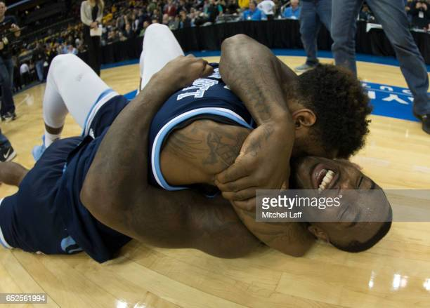 Jarvis Garrett and Jared Terrell of the Rhode Island Rams celebrate after the game against the Virginia Commonwealth Rams in the Championship game of...
