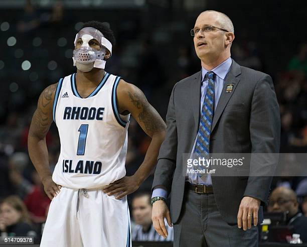 Jarvis Garrett of the Rhode Island Rams stands next to head coach Dan Hurley during the game against the Massachusetts Minutemen in the second round...