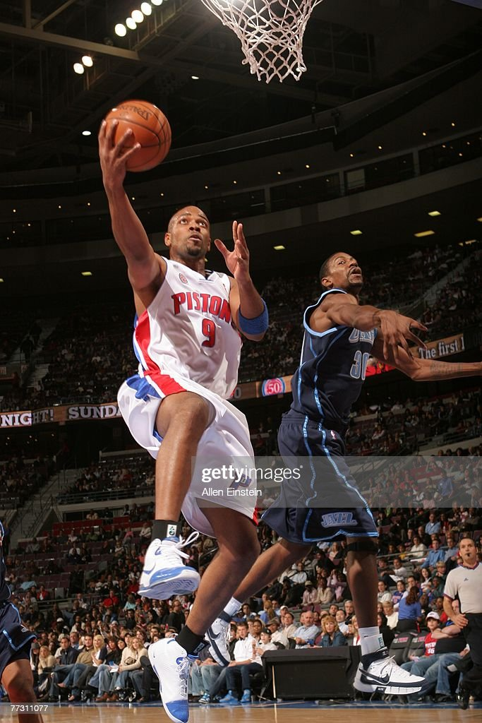 Jarvis Hayes #9 of the Detroit Pistons goes for a layup past Damone Browne #30 of the Utah Jazz during a preseason game on October 12, 2007 at the Palace of Auburn Hills in Auburn Hills, Michigan.