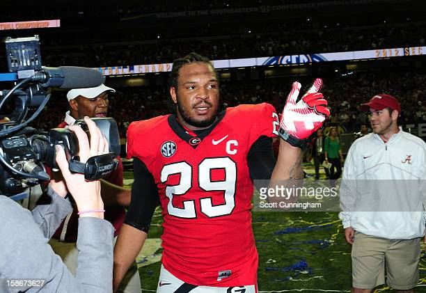 Jarvis Jones of the Georgia Bulldogs is interviewed after the SEC Championship Game against the Alabama Crimson Tide at the Georgia Dome on December...