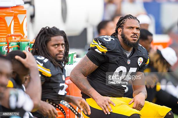 Jarvis Jones of the Pittsburgh Steelers looks at the scoreboard from the sidelines of a preseason game against the Buffalo Bills on August 29 2015 at...