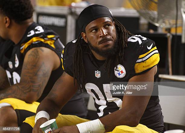 Jarvis Jones of the Pittsburgh Steelers looks on from the sidelines during a game against the Carolina Panthers at Heinz Field on August 28 2014 in...