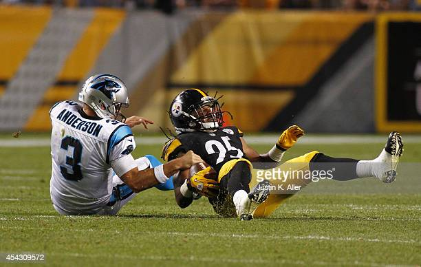 Jarvis Jones of the Pittsburgh Steelers recovers a fumble by Derek Anderson Carolina Panthers in the second quarter of a game against the Carolina...
