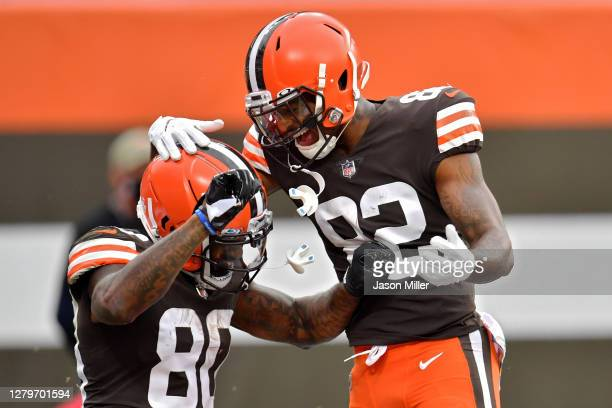 Jarvis Landry and Rashard Higgins of the Cleveland Browns celebrate after scoring a touchdown in the second quarter against the Indianapolis Colts at...