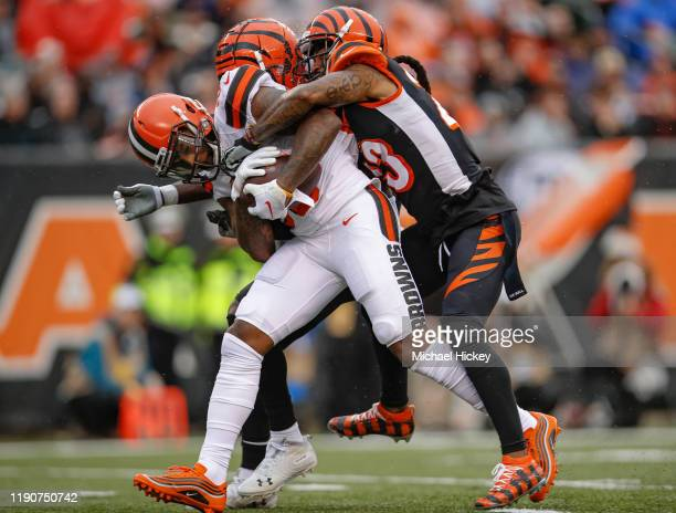 Jarvis Landry of the Cleveland Browns breaks away from the tackle of BW Webb of the Cincinnati Bengals and would go on to score a touchdown during...