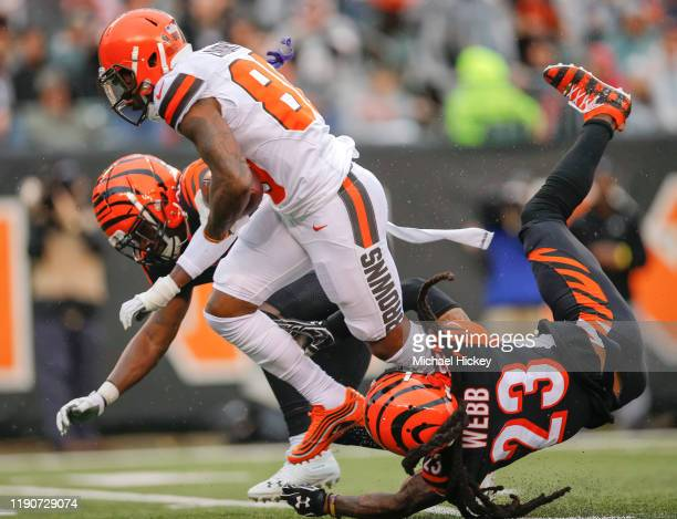 Jarvis Landry of the Cleveland Browns breaks the tackle of BW Webb of the Cincinnati Bengals and would run on for a touchdown during the first half...