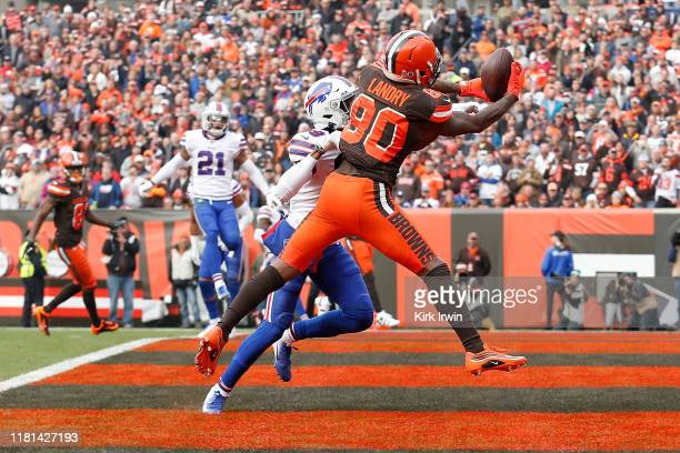 Jarvis Landry of the Cleveland Browns catches a pass for a touchdown while being defended by Levi Wallace of the Buffalo Bills during the first...
