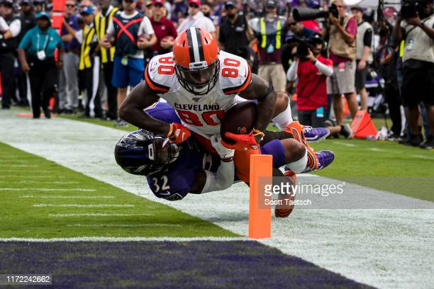 Jarvis Landry of the Cleveland Browns dives for the end zone as DeShon Elliott of the Baltimore Ravens defends during the second half at MT Bank...