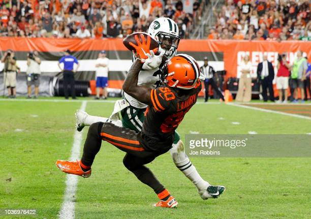 Jarvis Landry of the Cleveland Browns makes a catch in front of Doug Middleton of the New York Jets during the third quarter at FirstEnergy Stadium...
