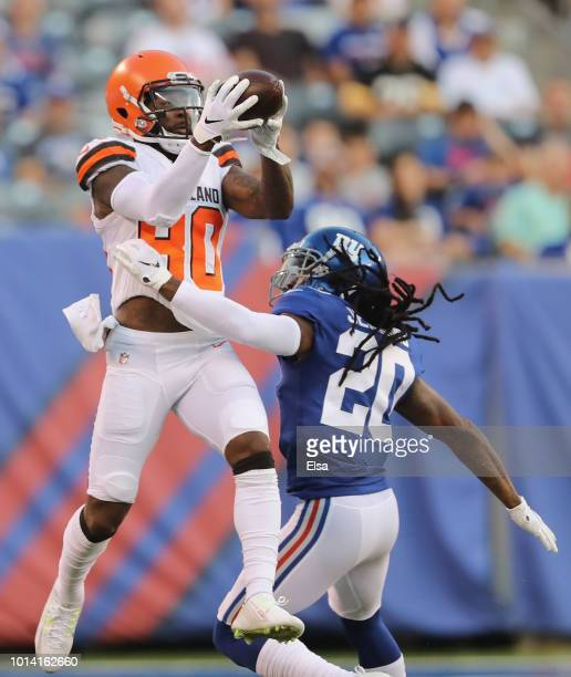 Jarvis Landry of the Cleveland Browns makes the catch as Janoris Jenkins of the New York Giants defends in the first quarter during their preseason...