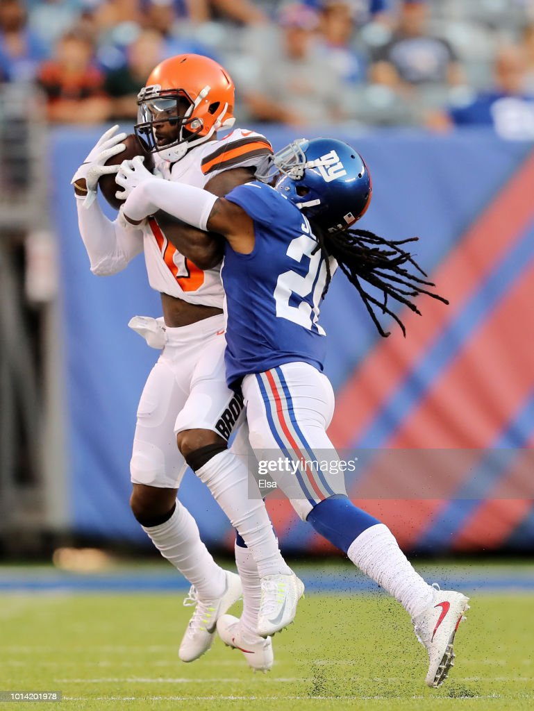 Jarvis Landry #80 of the Cleveland Browns makes the catch as Janoris Jenkins #20 of the New York Giants defends in the first quarter during their preseason game on August 9,2018 at MetLife Stadium in East Rutherford, New Jersey.