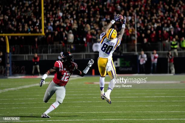 Jarvis Landry of the LSU Tigers catches a pass in front of Tony Connor of the Ole Miss Rebels during a game at VaughtHemingway Stadium on October 19...